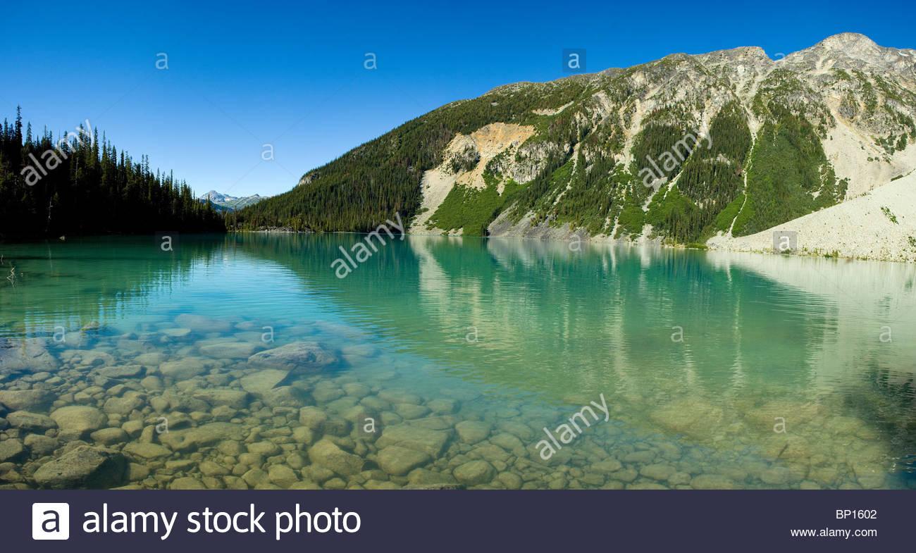 Glacier water of Upper Joffre Lake, Joffrey Lakes Provincial Park, British Columbia, Canada - Stock Image