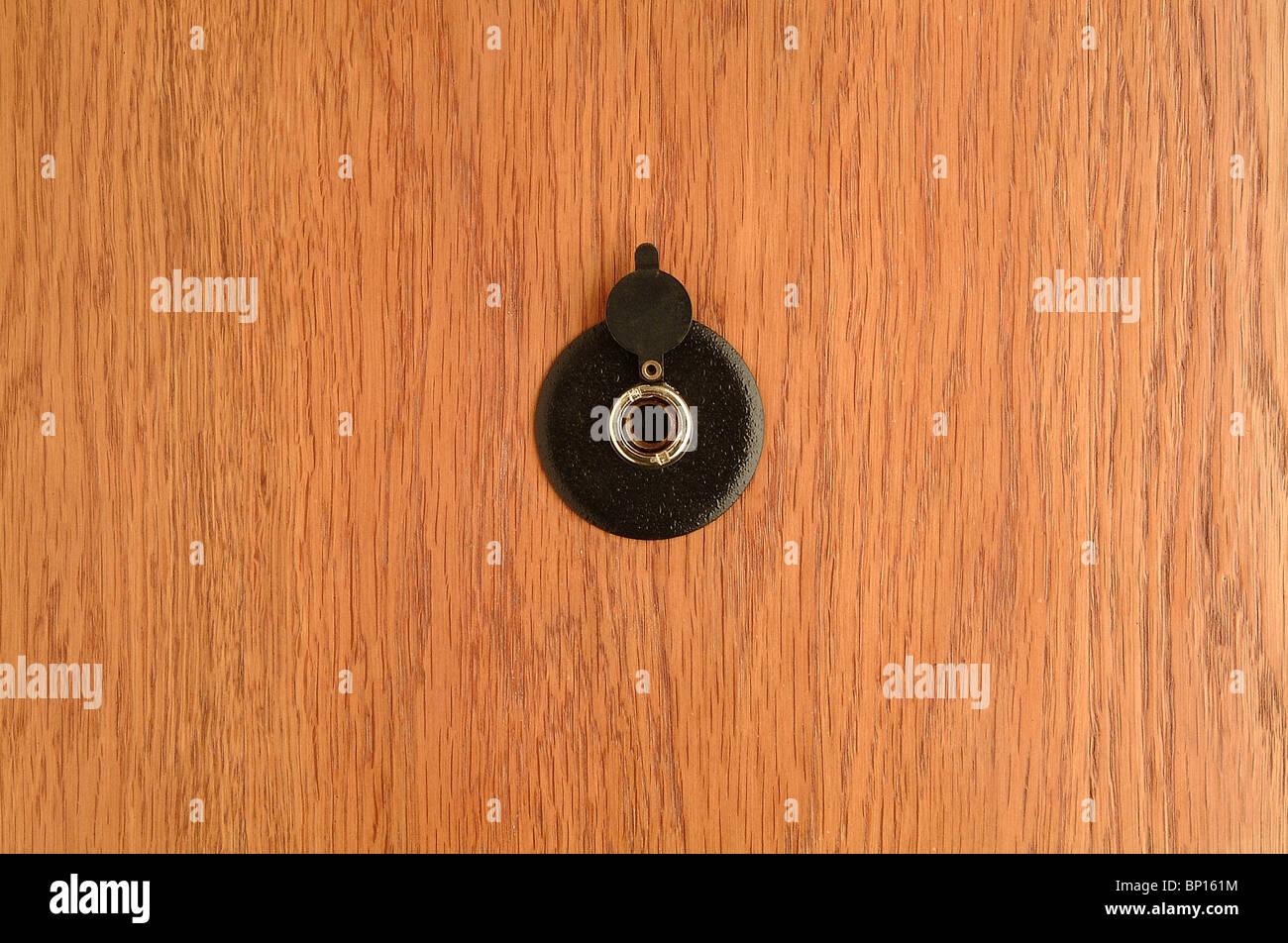 The spy hole on wooden doors & The spy hole on wooden doors Stock Photo: 30759504 - Alamy