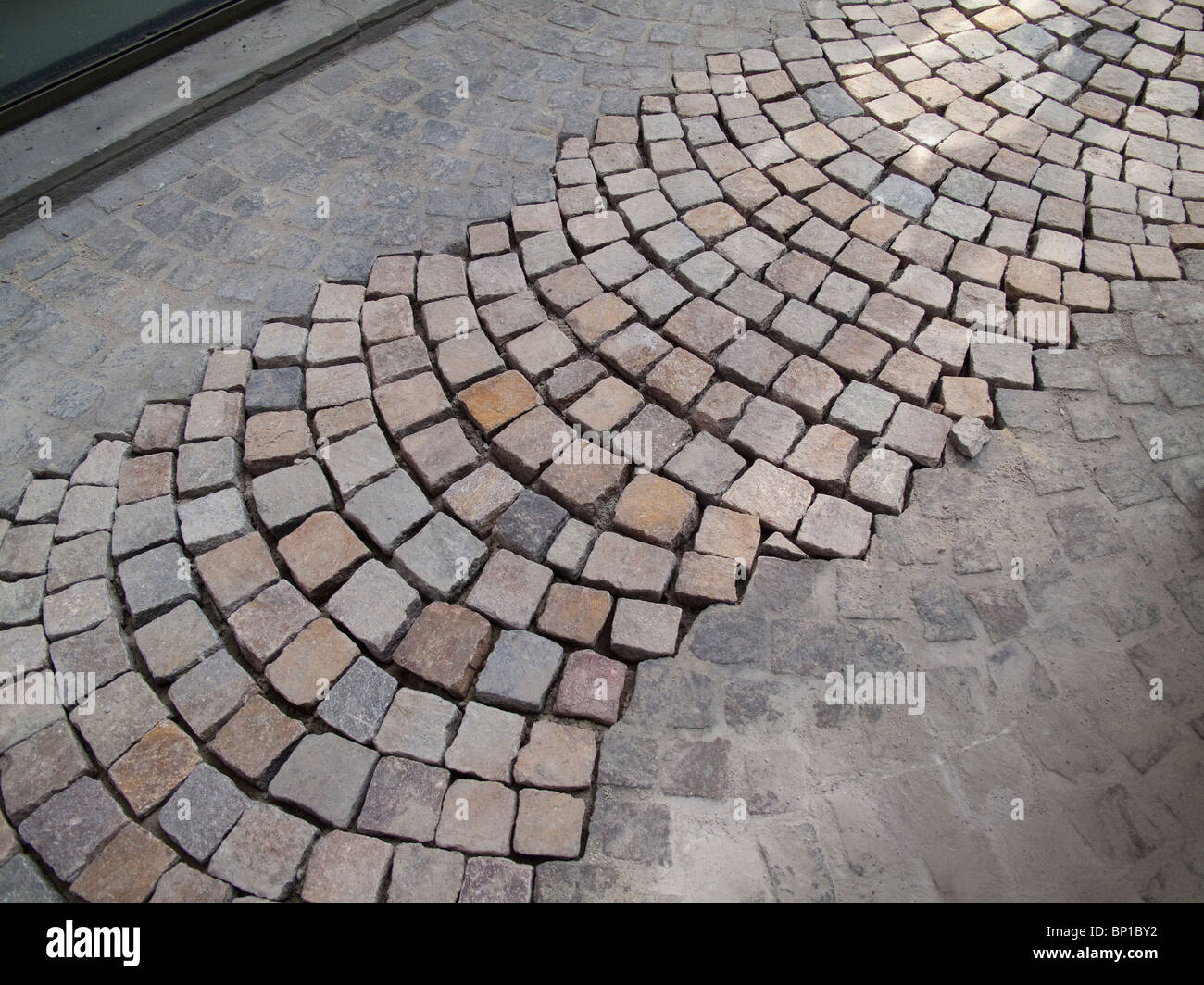 Brick paving being laid in Lille, France - Stock Image