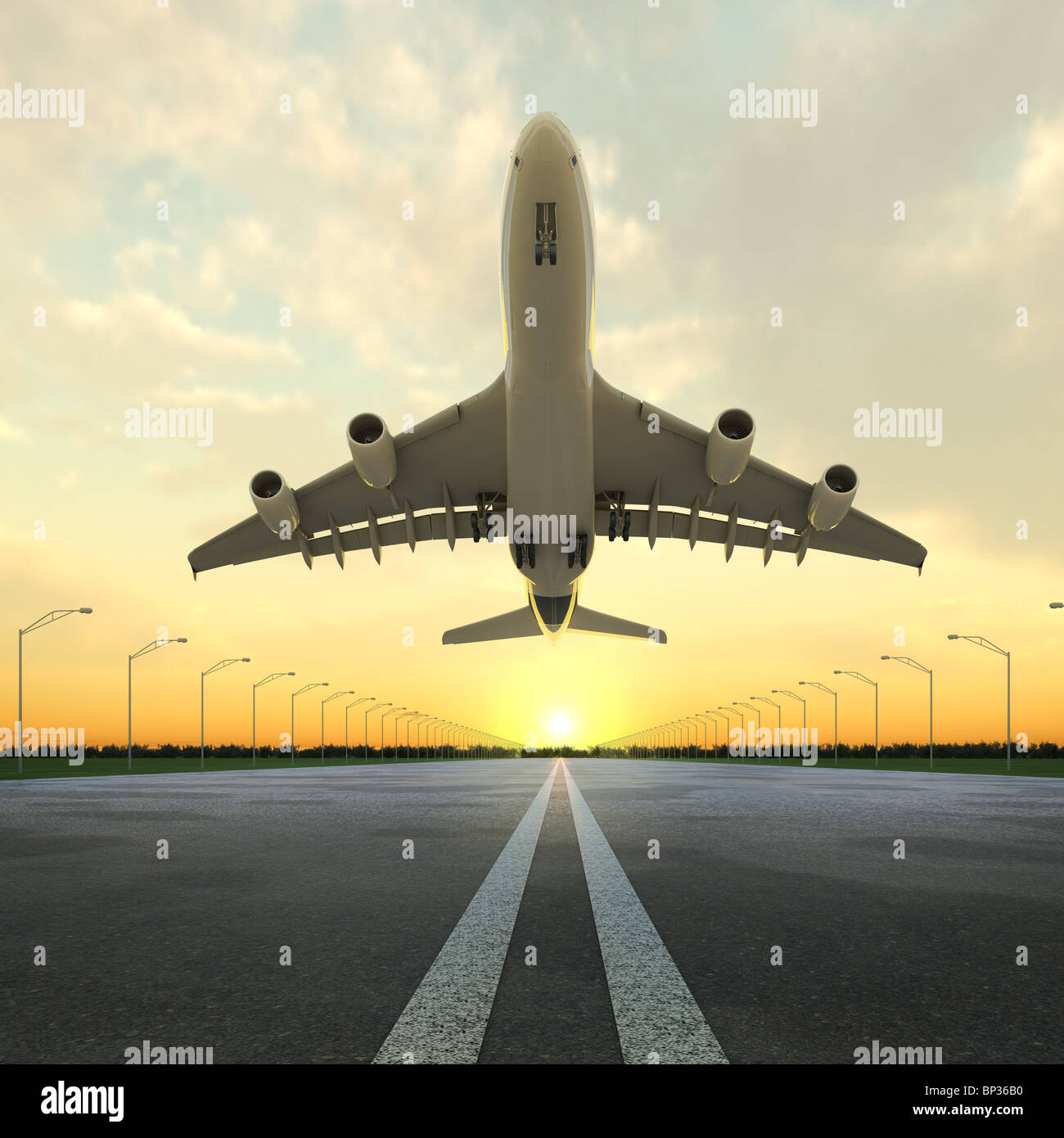 airplane at takeoff seen from the bottom in the airport landing strip at sunset. - Stock Image