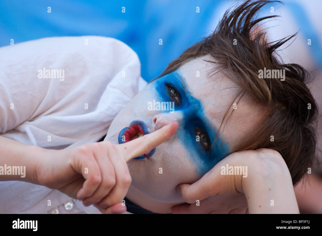 Performer at Edinburgh's fringe festival with face painted in Scotland's national colours. Stock Photo