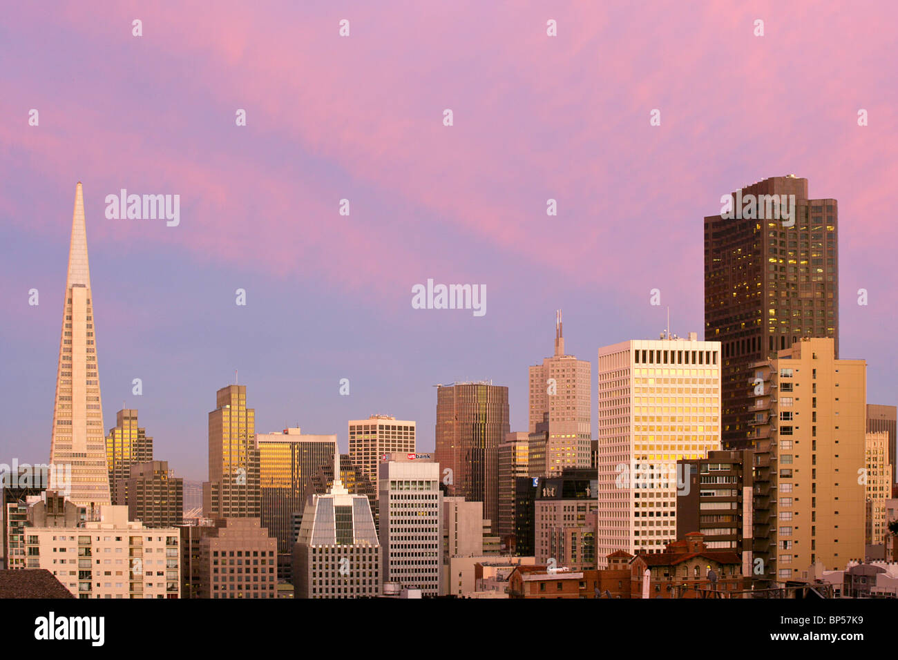The San Francisco skyline during a dramatic sunset - Stock Image