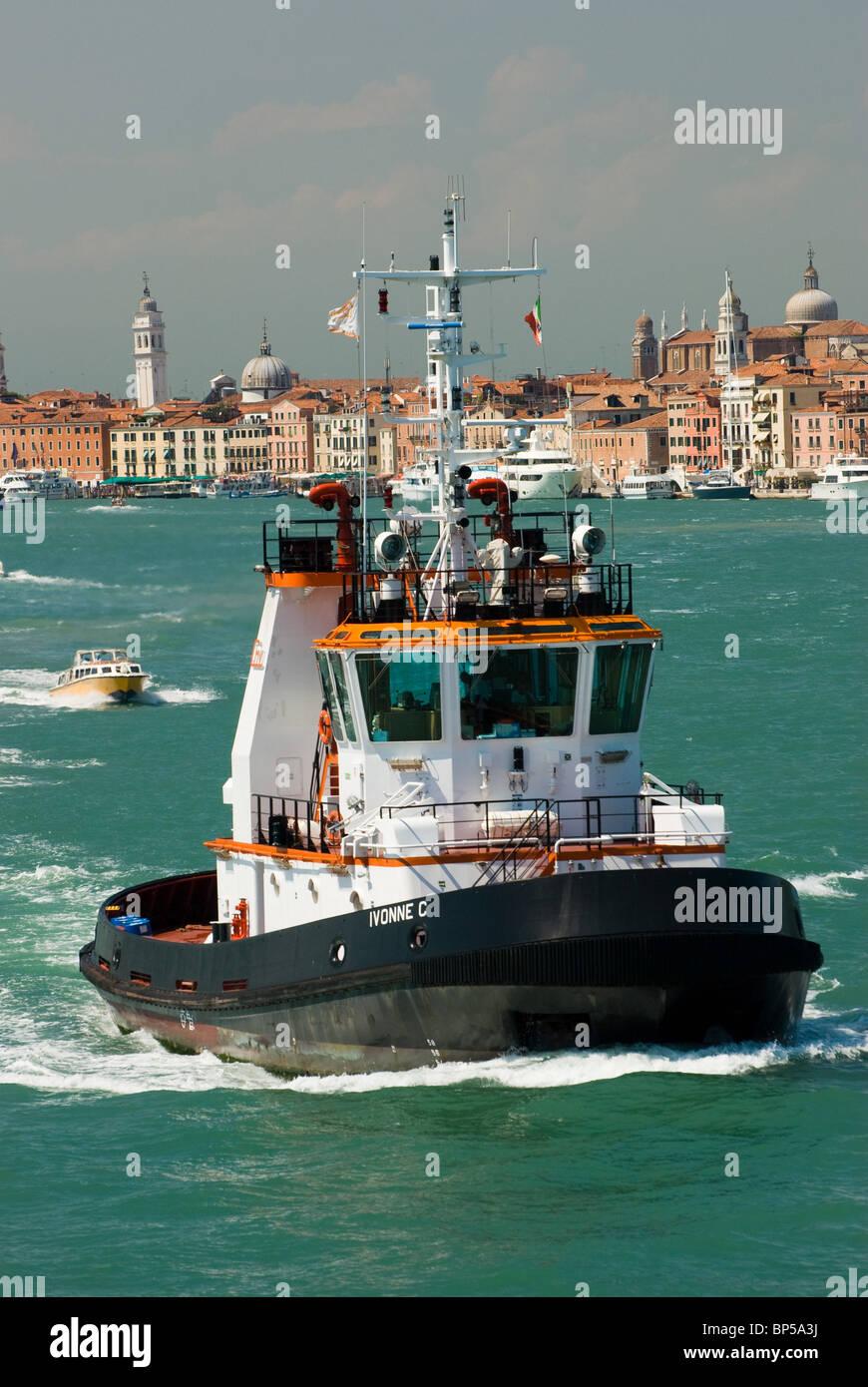 Tug boat on Canale della Giudecca, the approach to Venice, Italy near Lido di Venezia.. - Stock Image