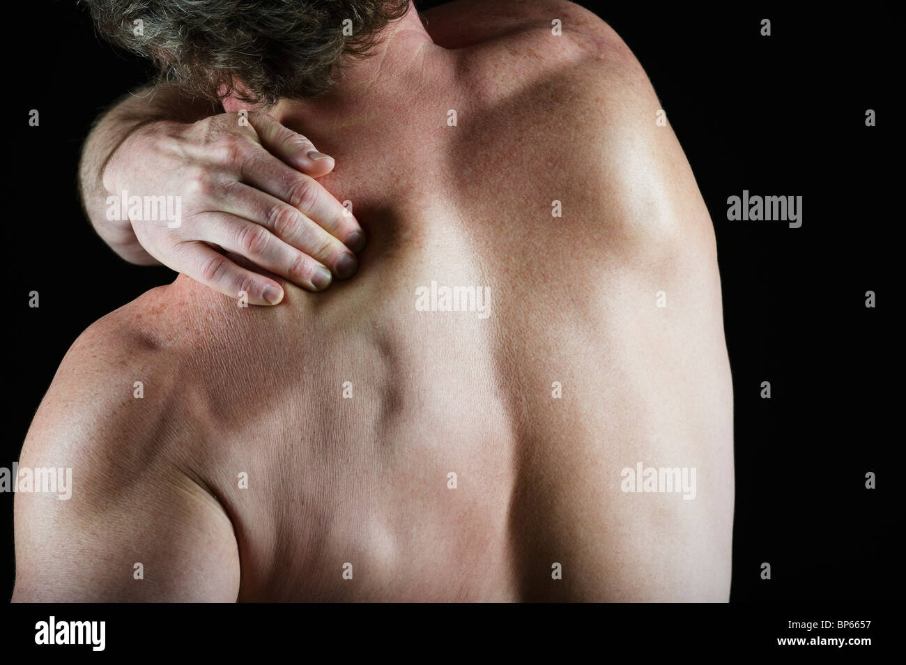 Man with shoulder painStock Photo