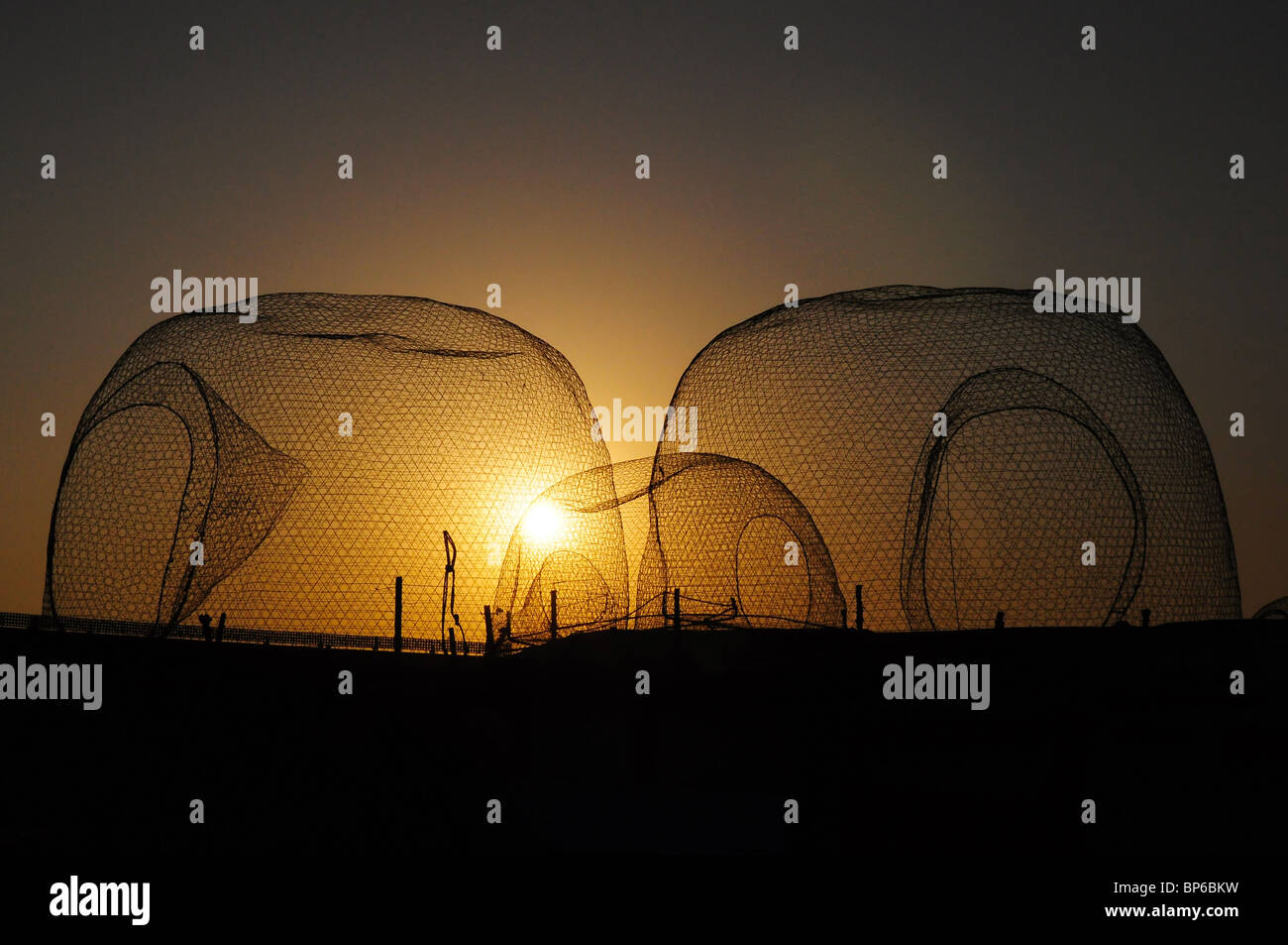 fishing nets, sunset - Stock Image