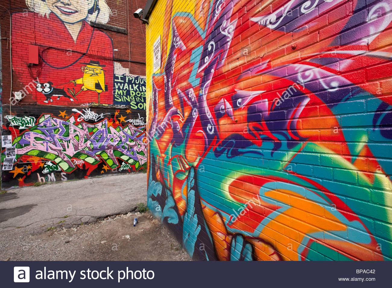 Graffiti on a wall in a back alley of the Fashion District near Queen West in Toronto Ontario Canada Stock Photo