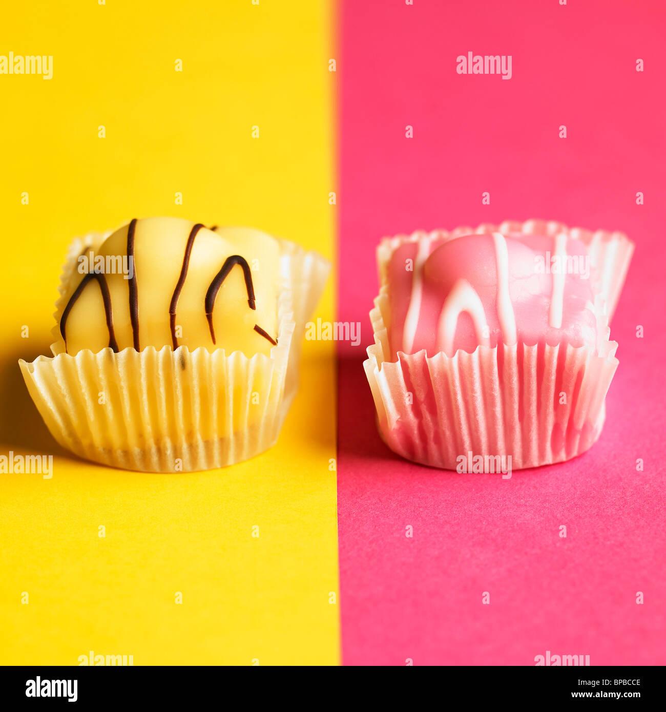 yellow-and-pink-fondant-fancies-on-yello