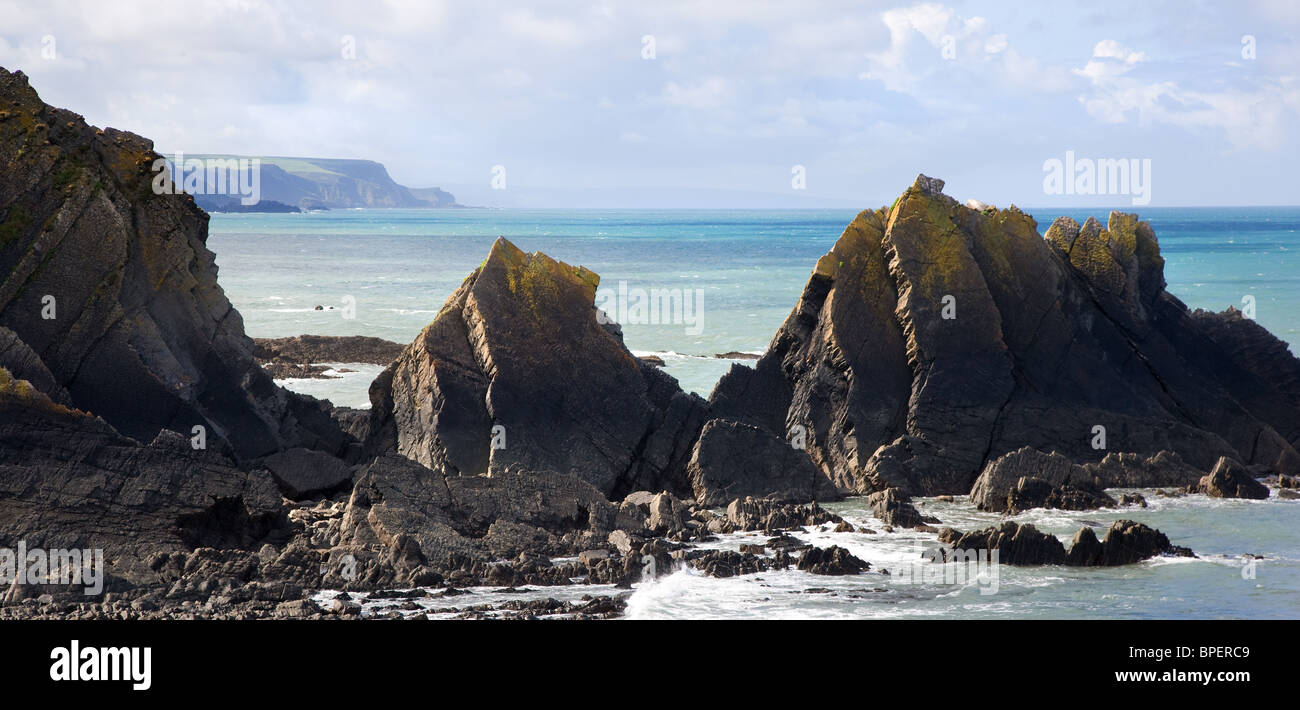 View of the Devon coast looking south from Hartland Quay through the rocks of Screda Point - Stock Image