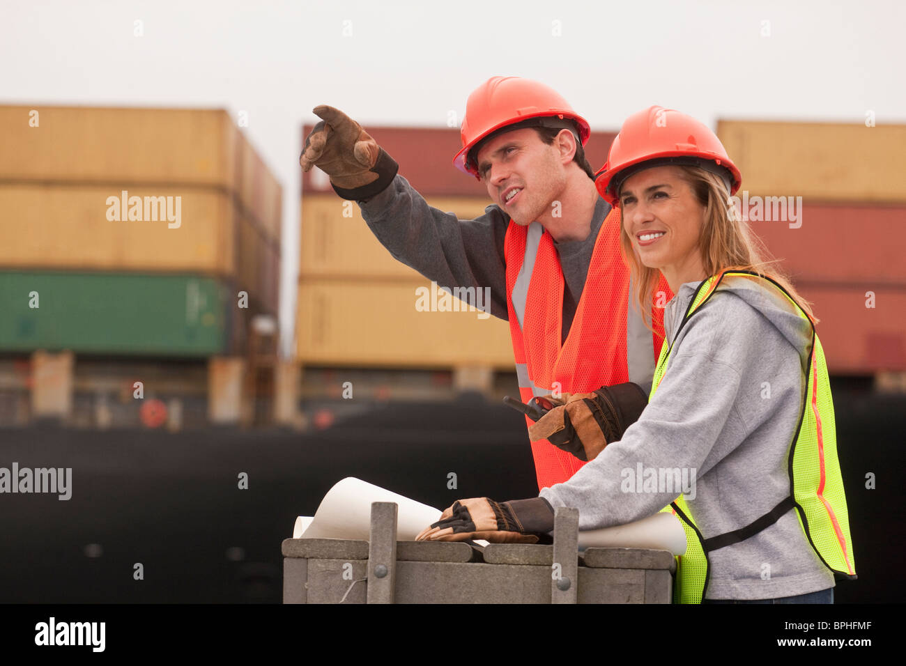 Transportation engineers working on a commercial dock - Stock Image