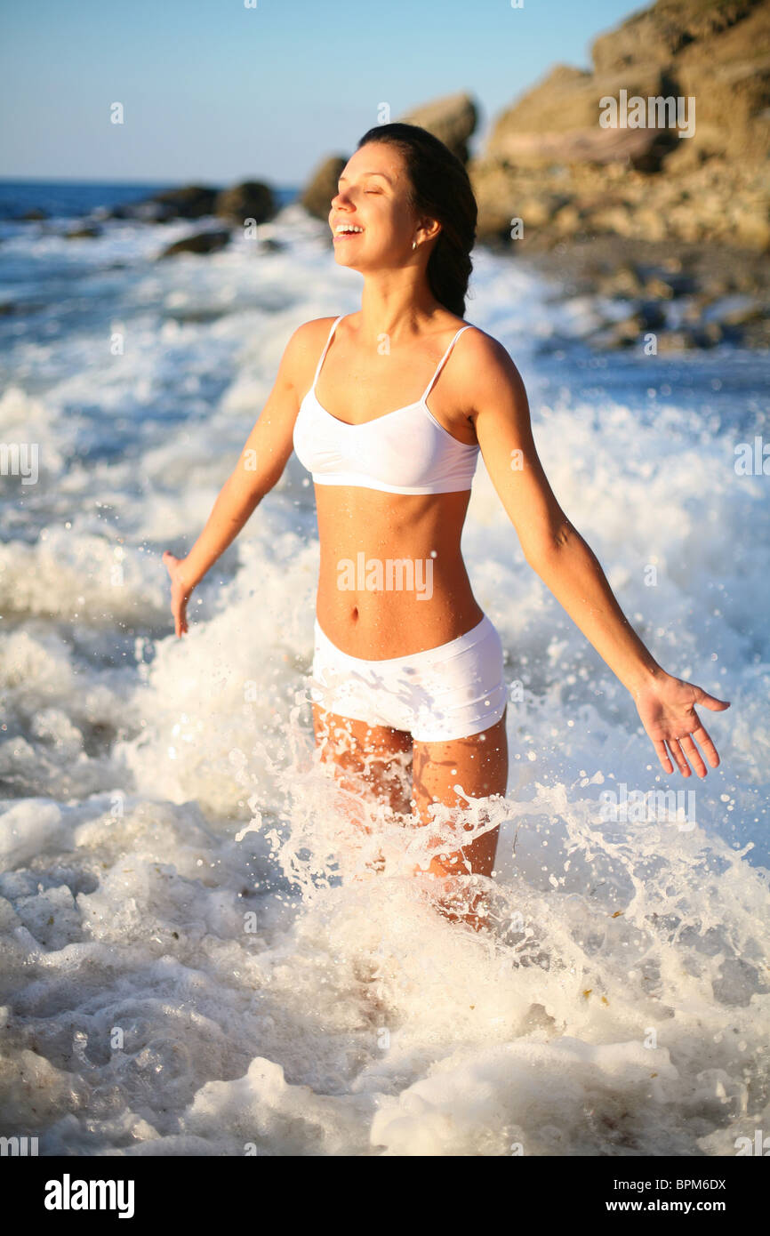 happy beautiful girl in the sea waves - Stock Image