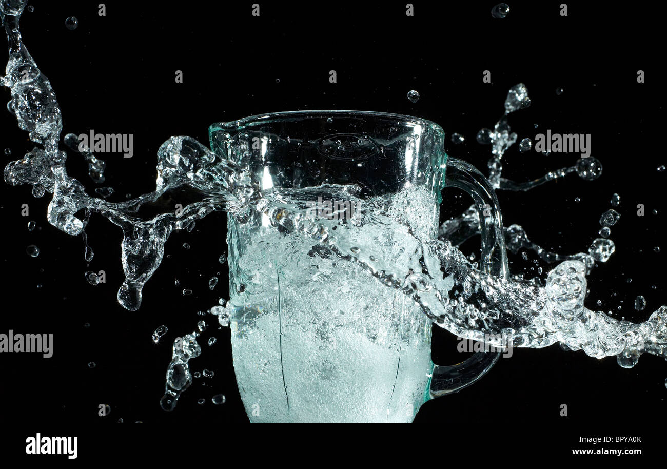 dynamic water splash on a black background - Stock Image
