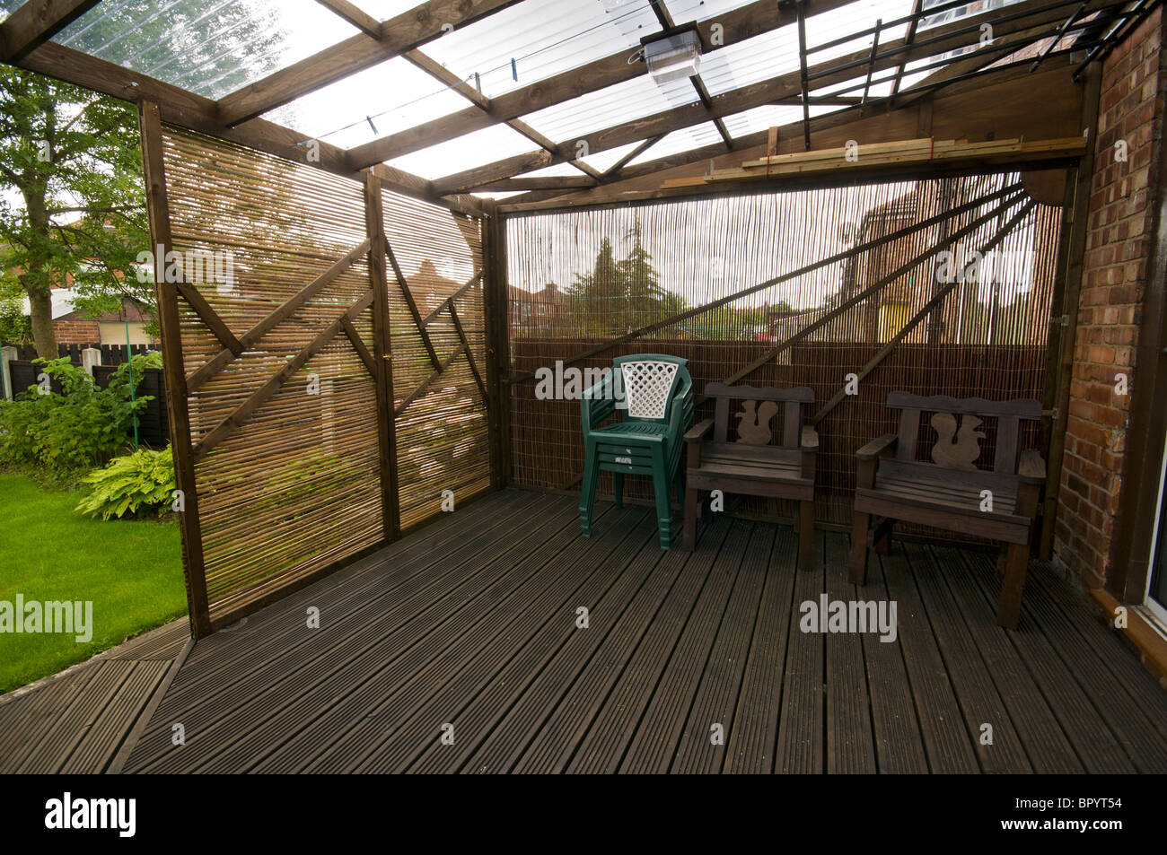 Home Built Patio Decking With Corrugated Plastic Roofing