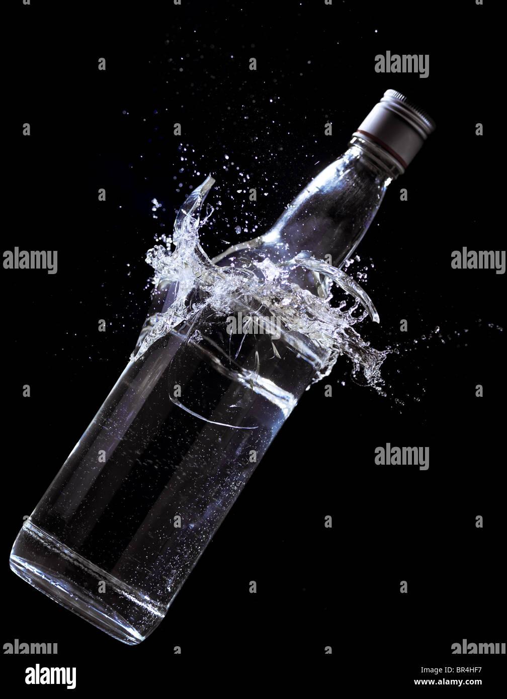 Alcohol bottle breaking - Stock Image