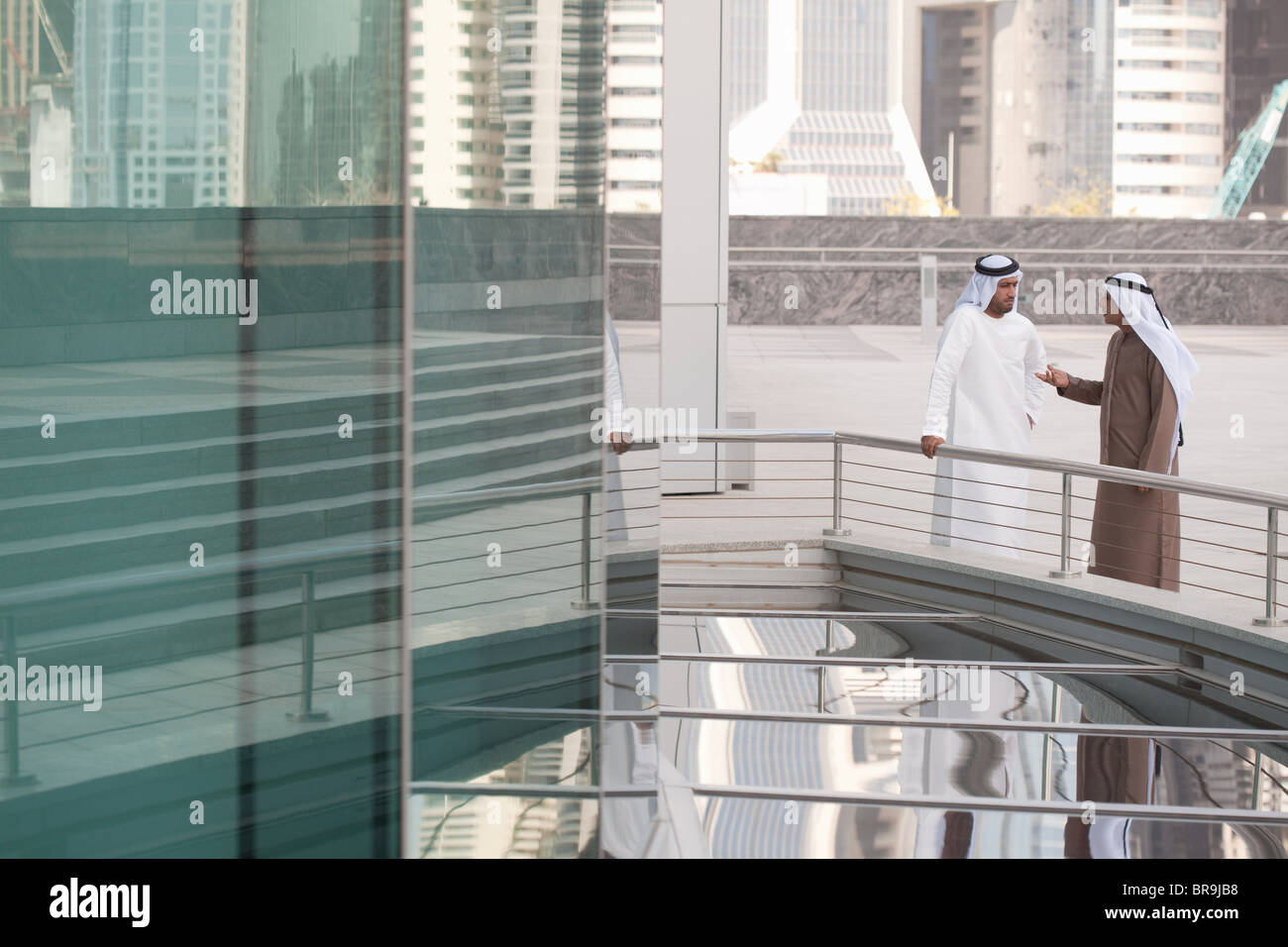 Middle eastern businessmen by office building - Stock Image