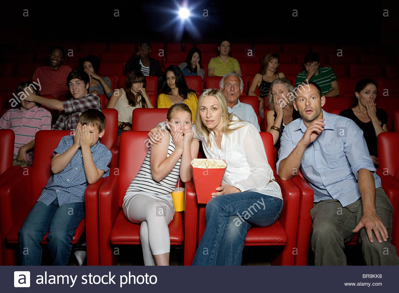 shocked family in movie theater stock photo 31560460 alamy