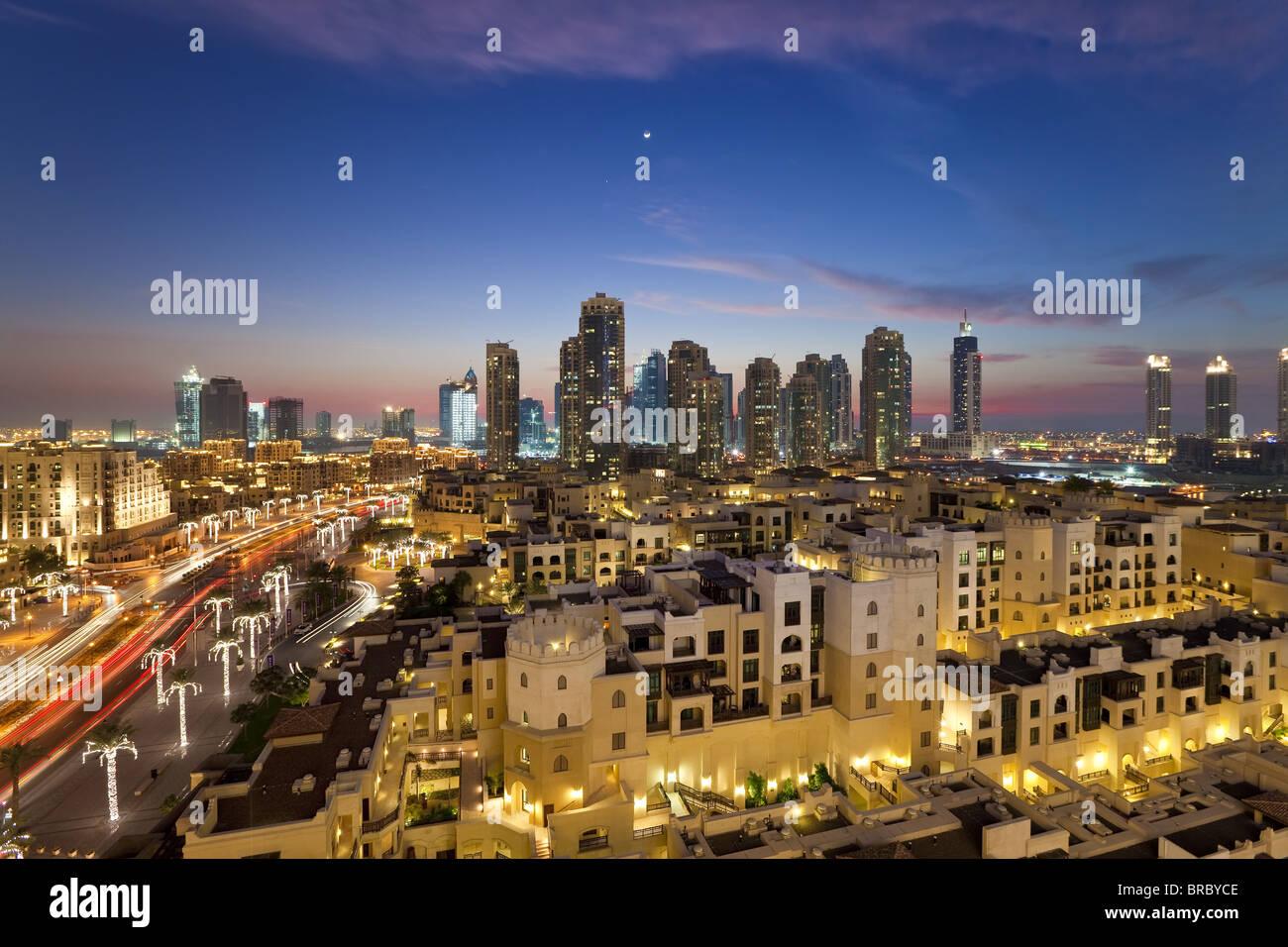 The Palace Hotel in the grounds of the Burj Khalifa park viewed towards the high rises of Dubai Marina area, Dubai, - Stock Image