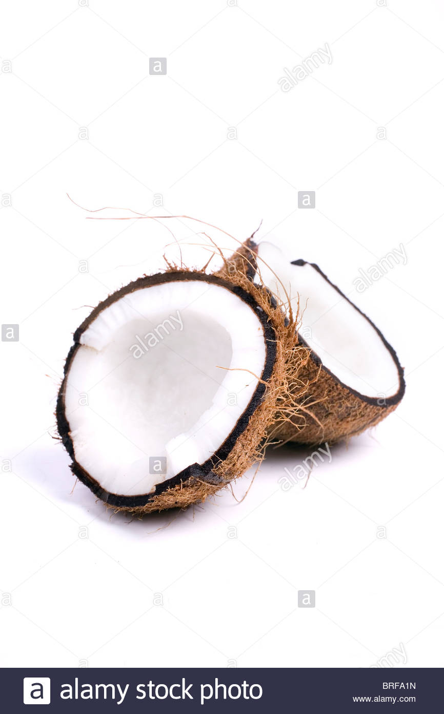 Two half coconuts against white background - Stock Image