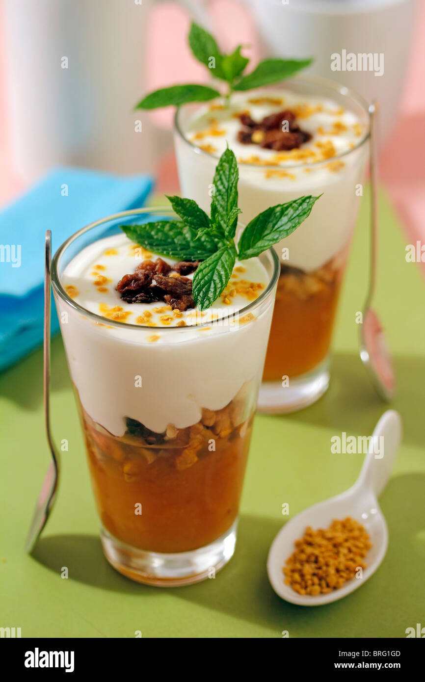 Yogurt with walnuts and pollen. Recipe available. - Stock Image