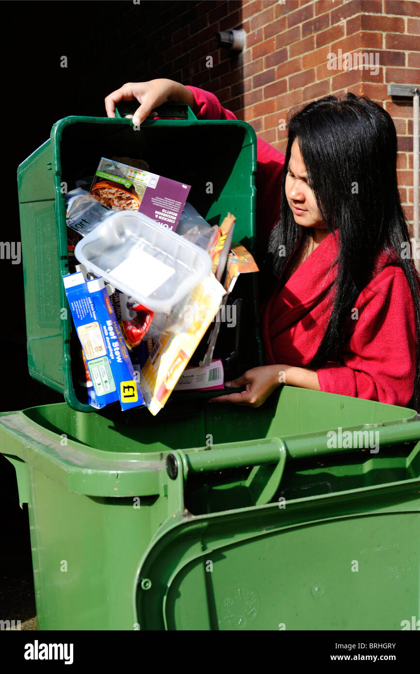 woman emptying recyclables into a wheeled bin england uk Stock Photo