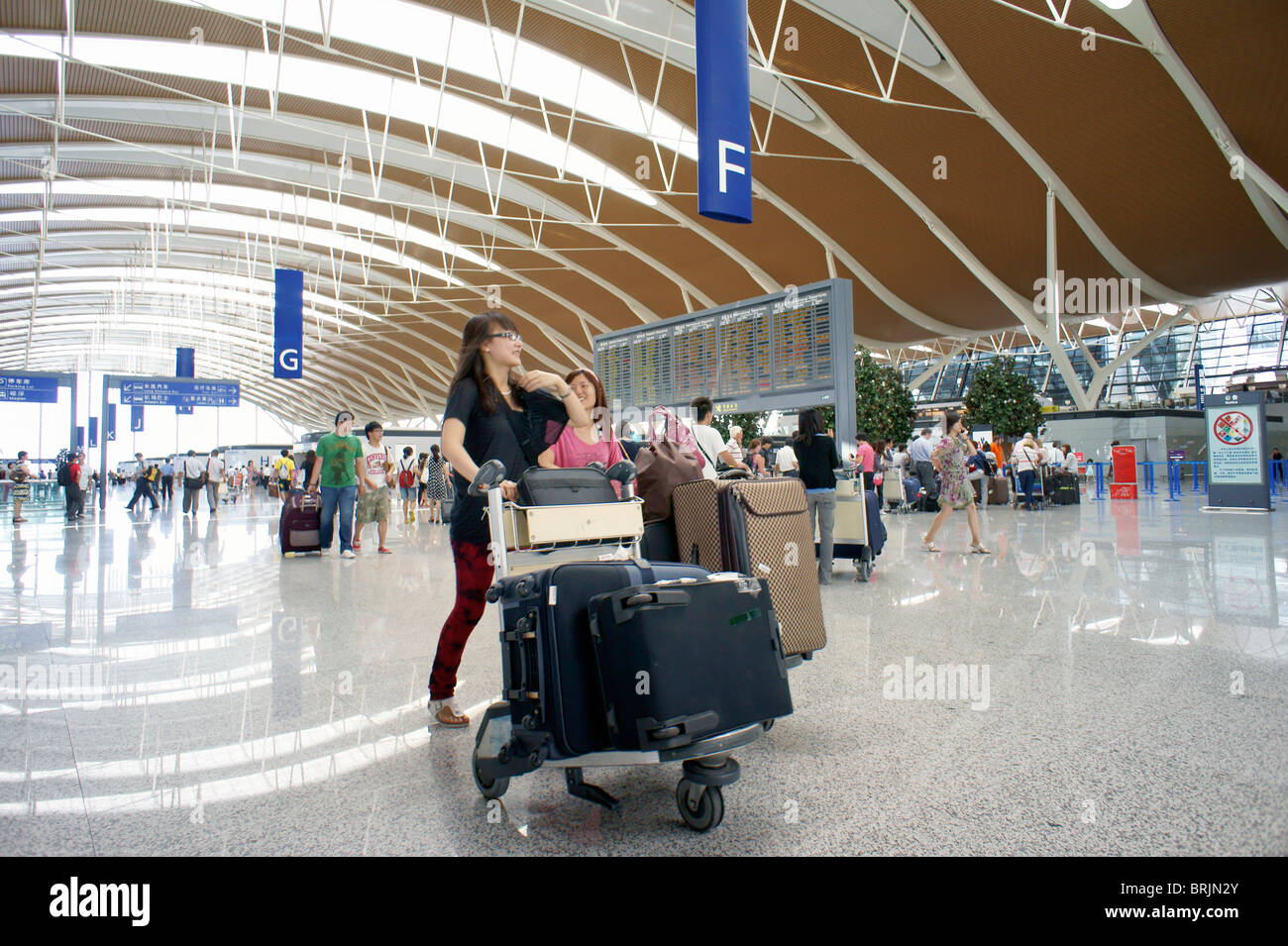 Shanghai, China. Main concourse departure lounge with flight notice board, Pudong International Airport, Shanghai Stock Photo