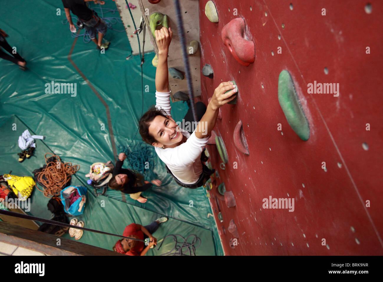 Girl in indoor climbing wall - Stock Image