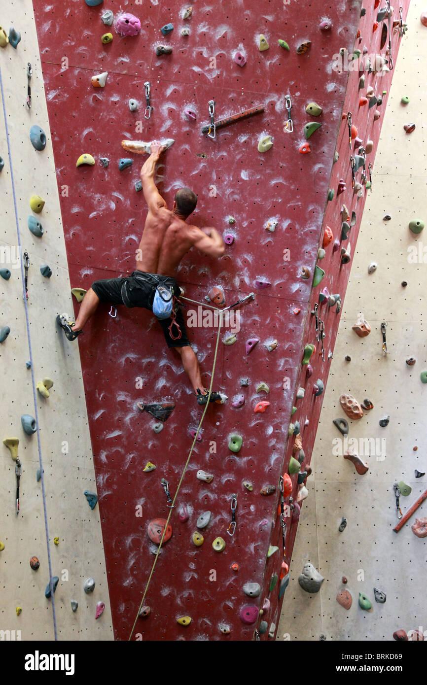 Man on indoor climbing wall - Stock Image