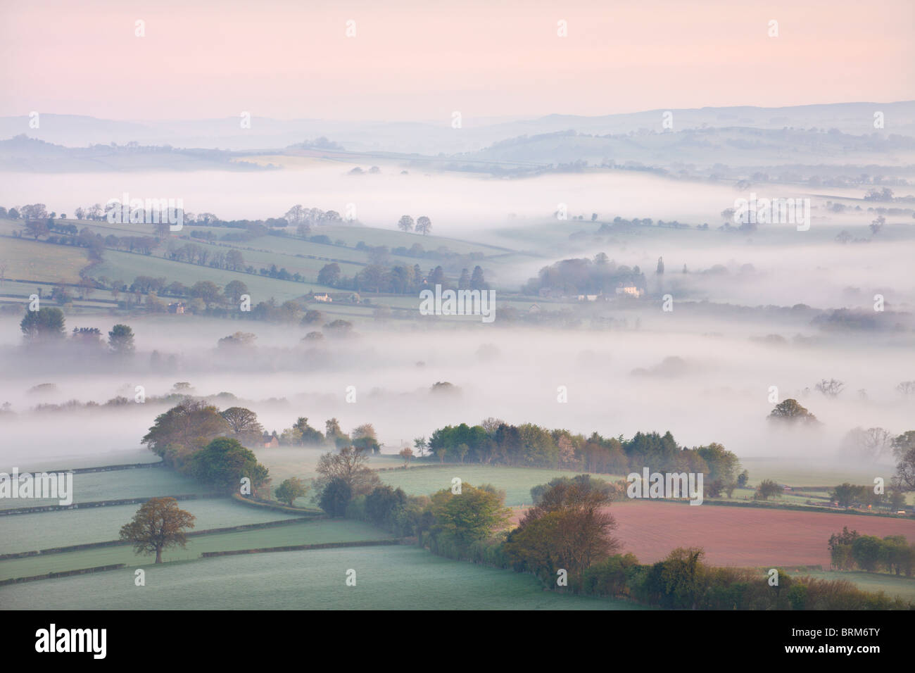 Mist covered countryside at dawn near Pennorth, Brecon Beacons National Park, Powys, Wales. Spring (May) 2010. - Stock Image