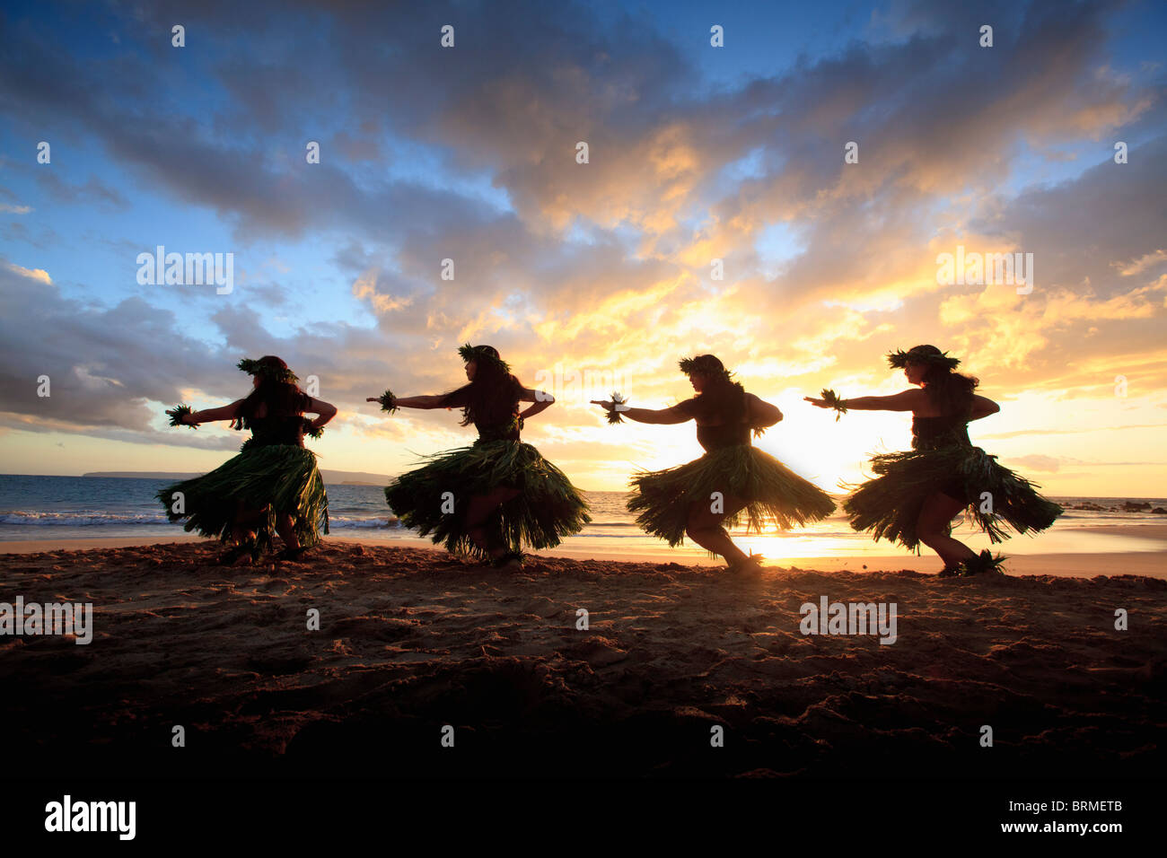 silhouette-of-hula-dancers-at-sunset-at-palauea-beach-maui-hawaii-BRMETB.jpg