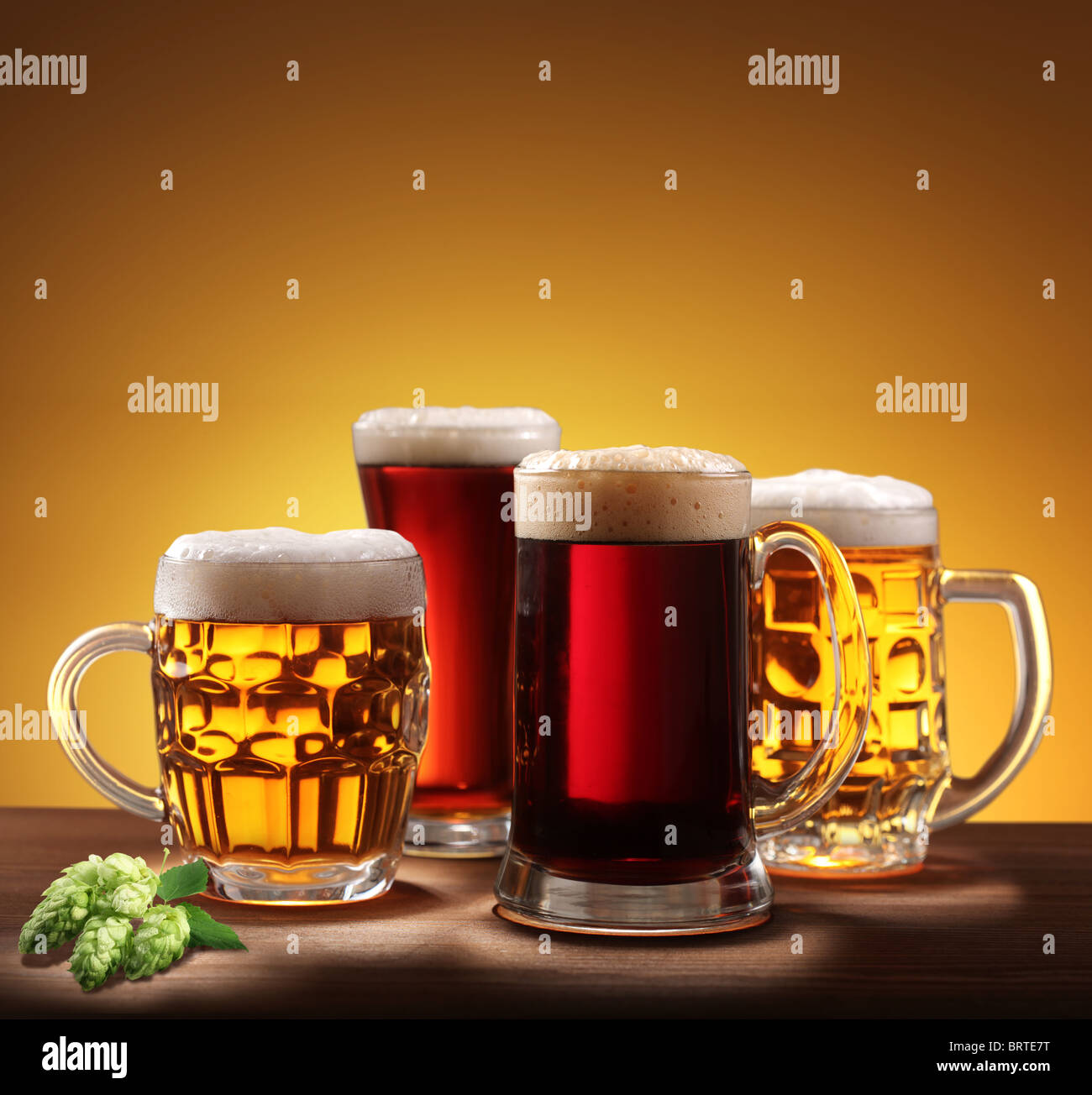Still-life with beer glasses. On a yellow background. - Stock Image