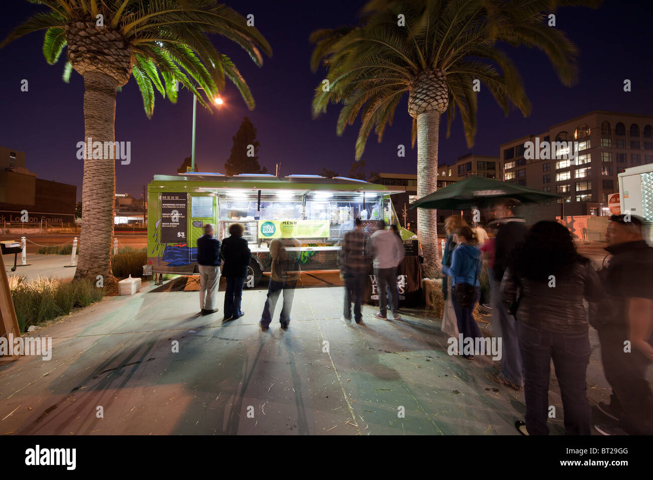 Night image of a taco truck at the annual Eat Real Food Festival in Oakland's Jack London Square. - Stock Image