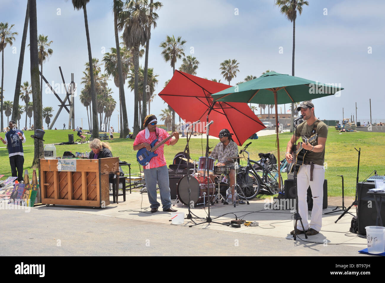 group-of-street-musicians-band-playing-guitar-piano-drums-singing-BT97JH.jpg