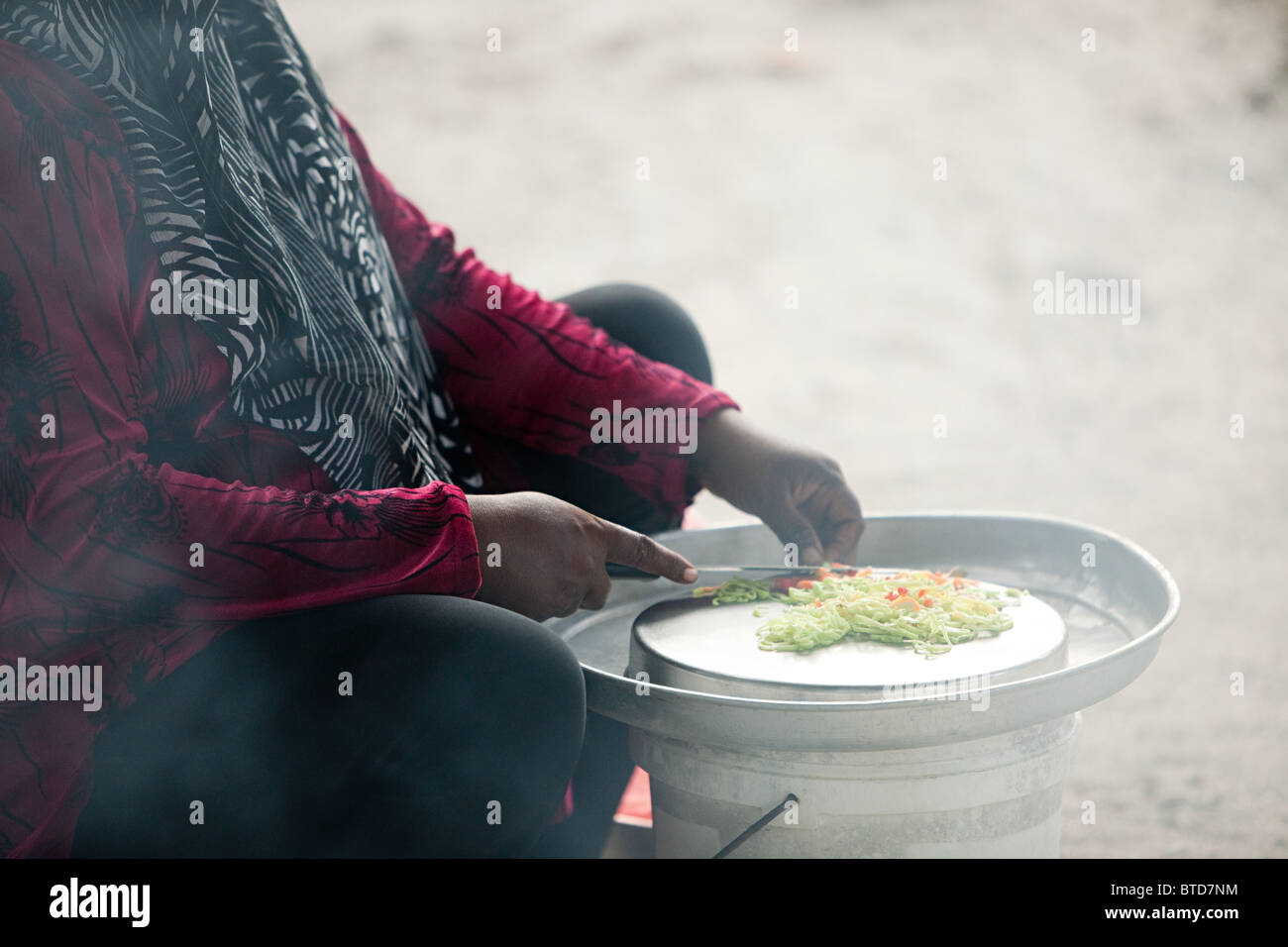 Person making curry, Gan Island, Laamu Atoll, Maldives - Stock Image