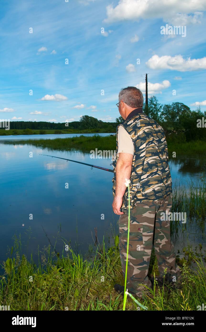 fisherman on river - Stock Image