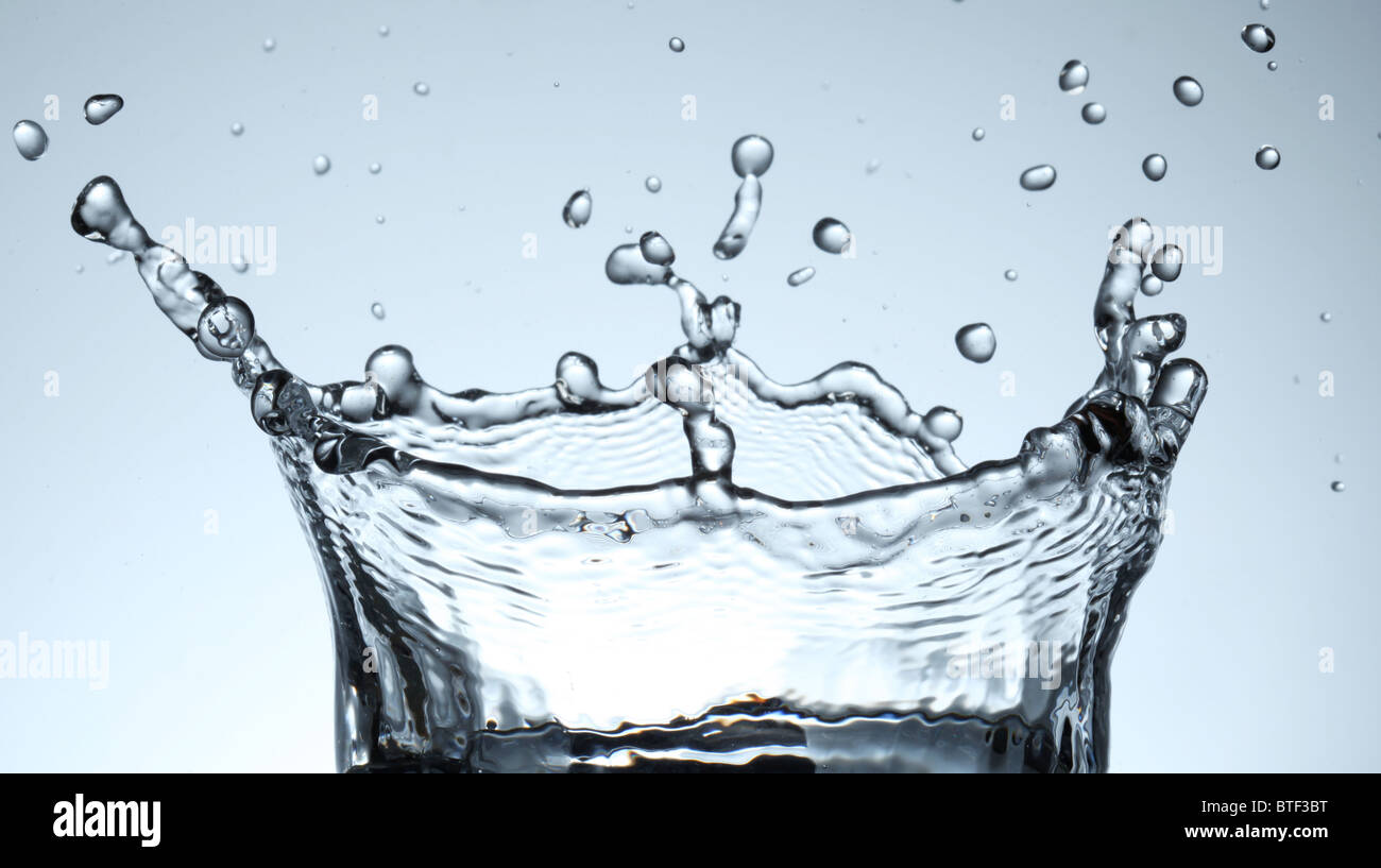 Splash water forms a water-crown. - Stock Image