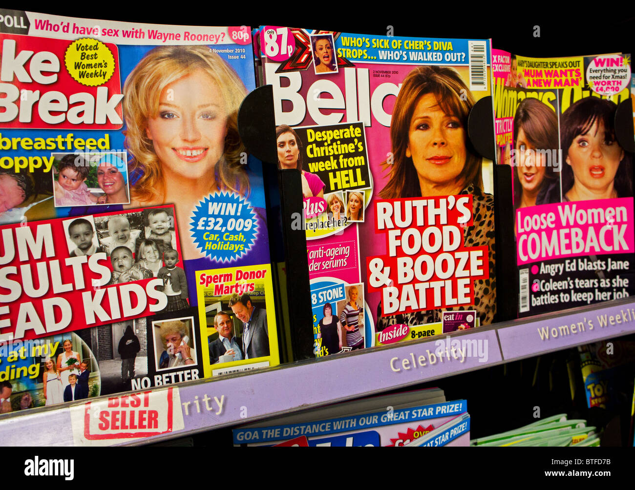 Consumer chat magazines for sale in a newsagents shop. - Stock Image