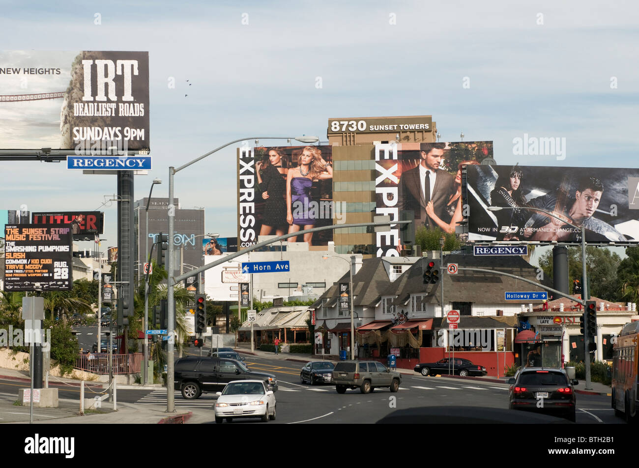 Giant billboards on Sunset Boulevard Hollywood Los Angeles California USA - Stock Image