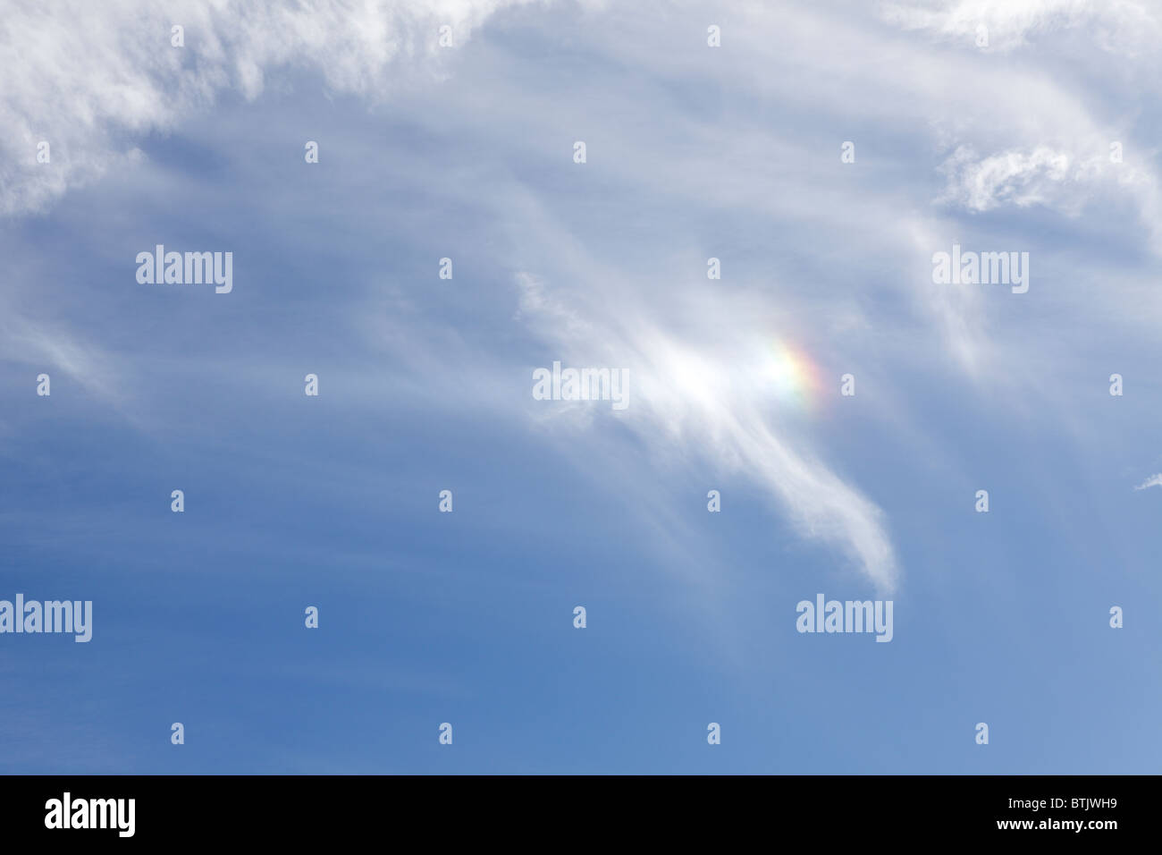 Viewed in July this year a Sun-dog or Parhelion one of five consecutive images taken in Acton Burnell in Shropshire. - Stock Image