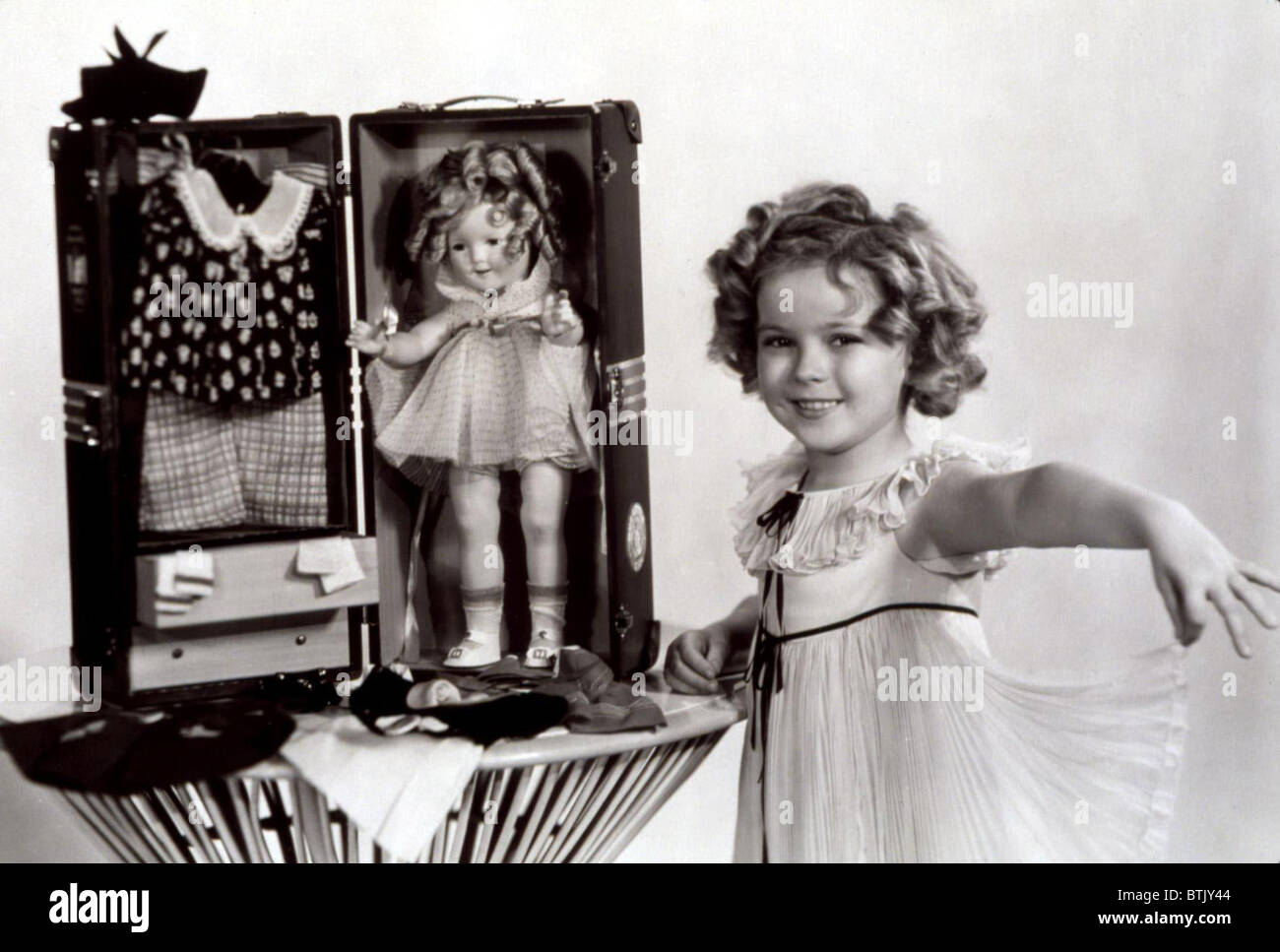 Shirley Temple with a Shirley Temple doll kit, 1935 Stock Photo