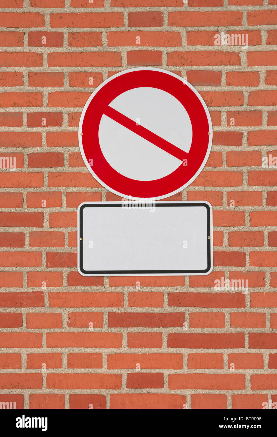 Prohibition sign with blank letter plate on brick wall. Template to put any icon and text on. - Stock Image