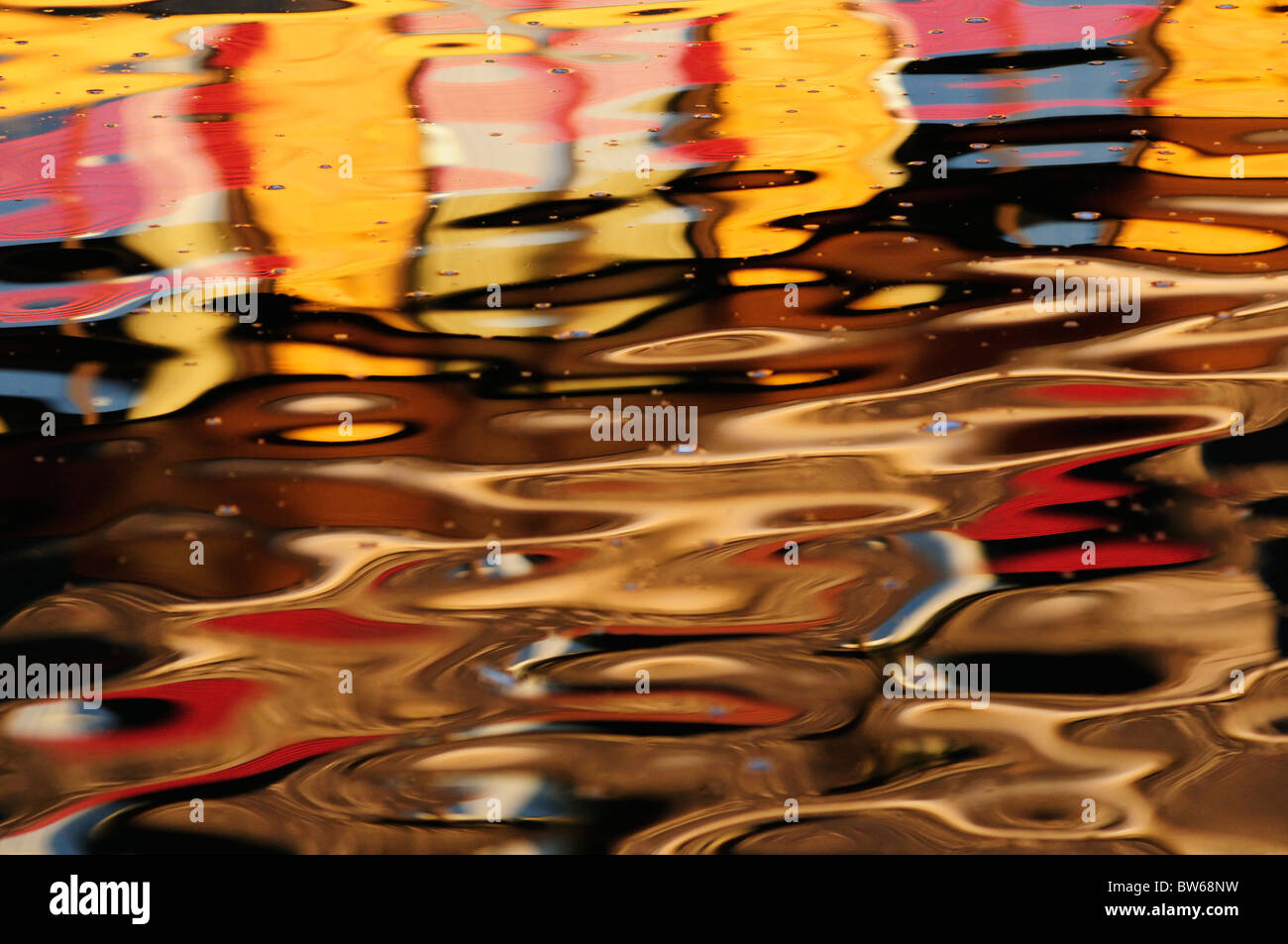 Abstract colourful reflection of Buildings in The River Cam, Cambridge, England, UK - Stock Image