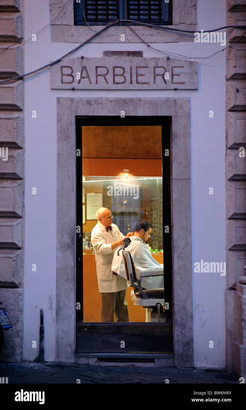 night-shot-of-a-barber-shop-situated-at-the-junction-of-via-dei-portoghesi-BW6NRY.jpg