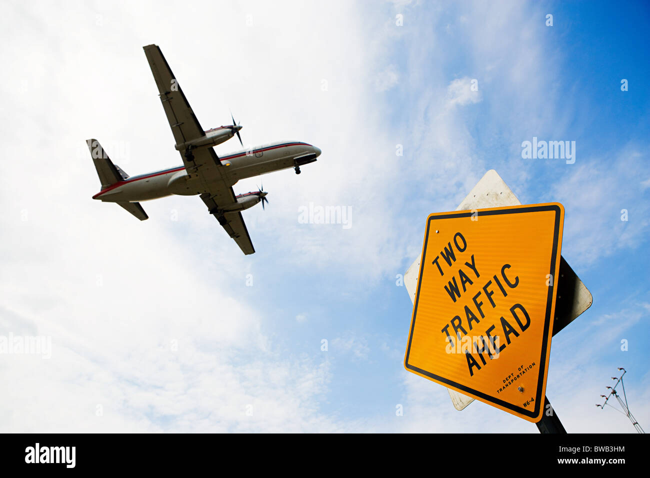 Airplane and sign - Stock Image