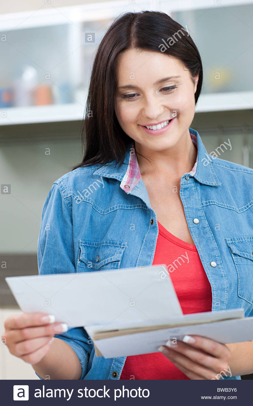 Young woman holding letters - Stock Image