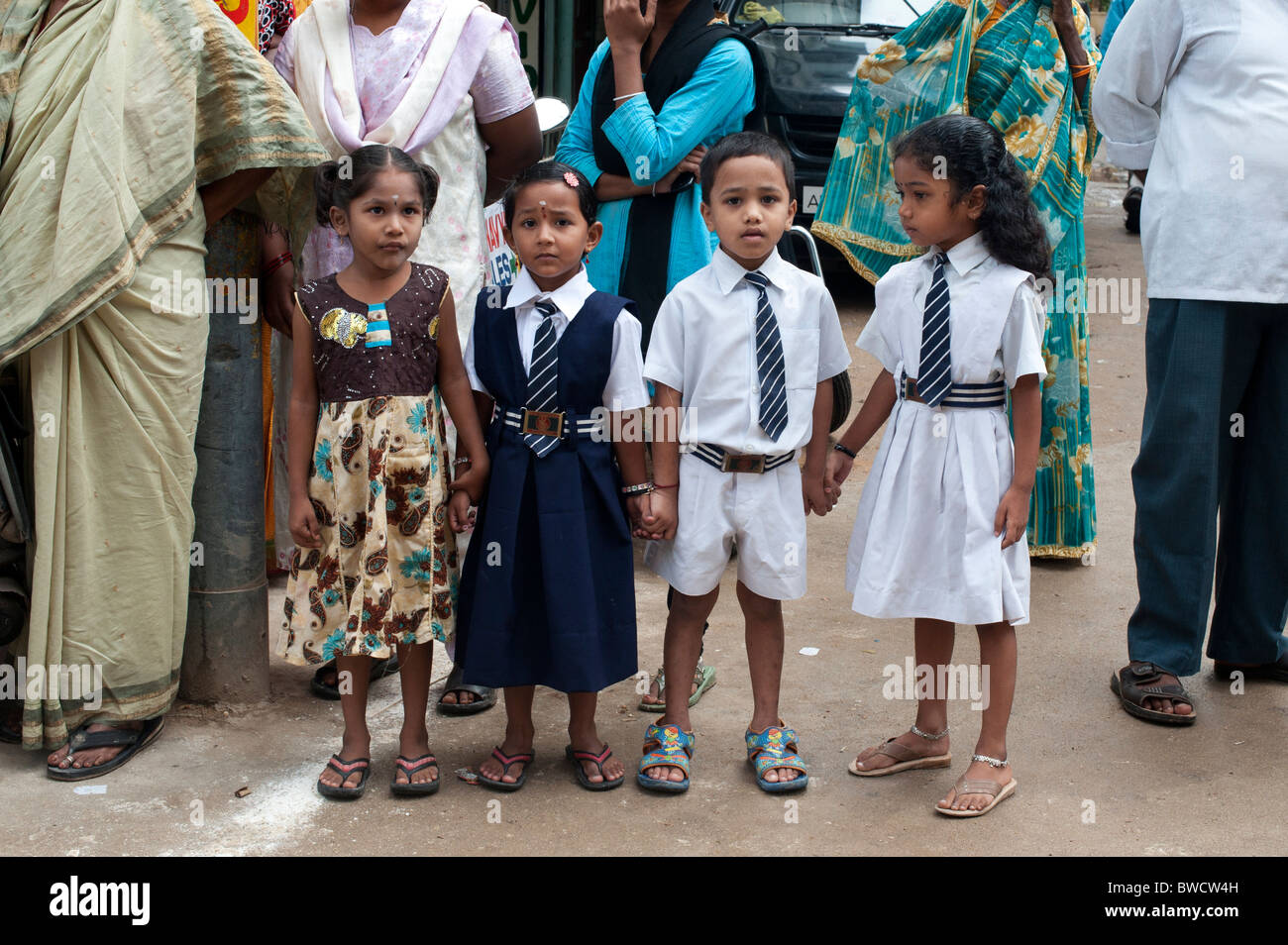 Indian school children in a crowd on the street of Puttaparthi, Andhra Pradesh, India - Stock Image