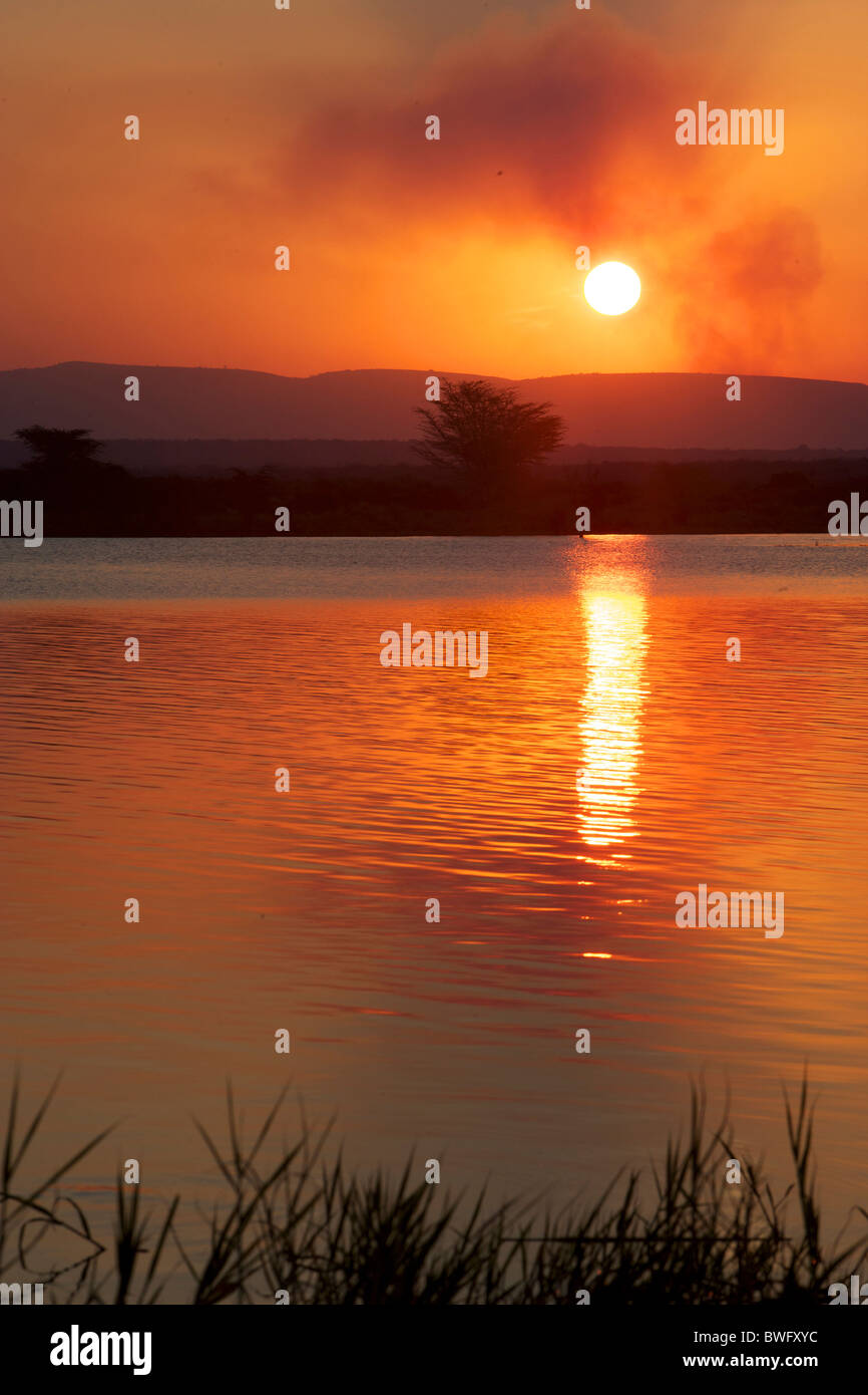 Sunset over water at Isimangaliso, Kwazulu-Natal, South Africa - Stock Image