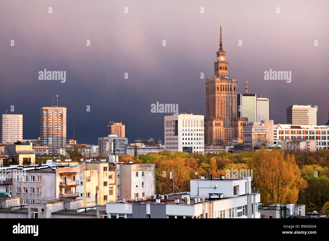 Warsaw, capital city of Poland, featuring Palace of Culture and Science, Srodmiescie district. Sunset time, stormy - Stock Image