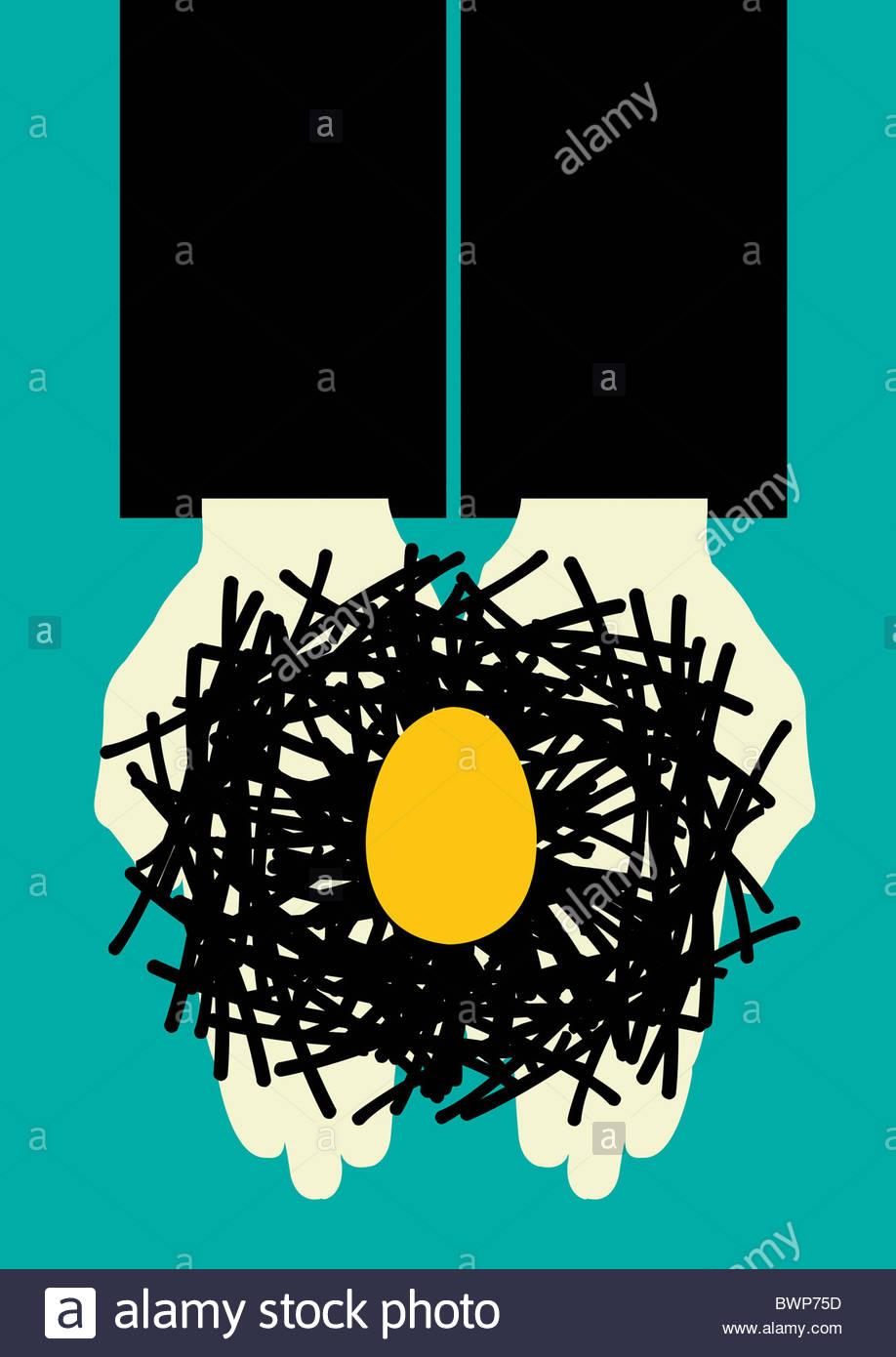 Hands holding egg in nest - Stock Image
