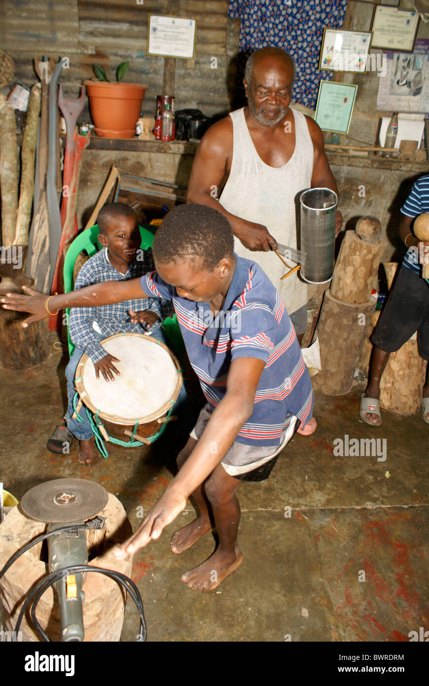 man-and-his-grandsons-playing-traditiona