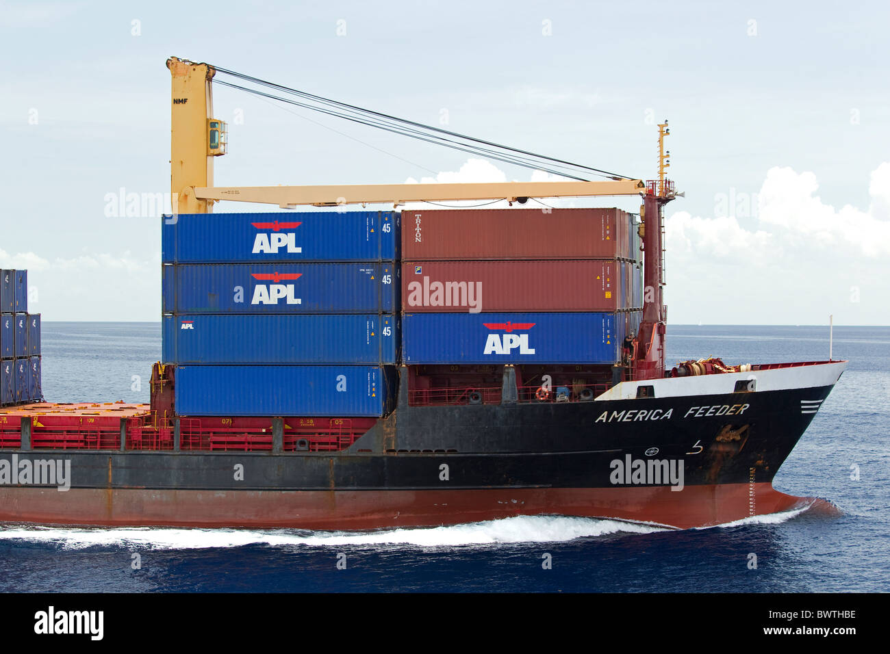 Cargo ship at sea with shipping containers - Stock Image