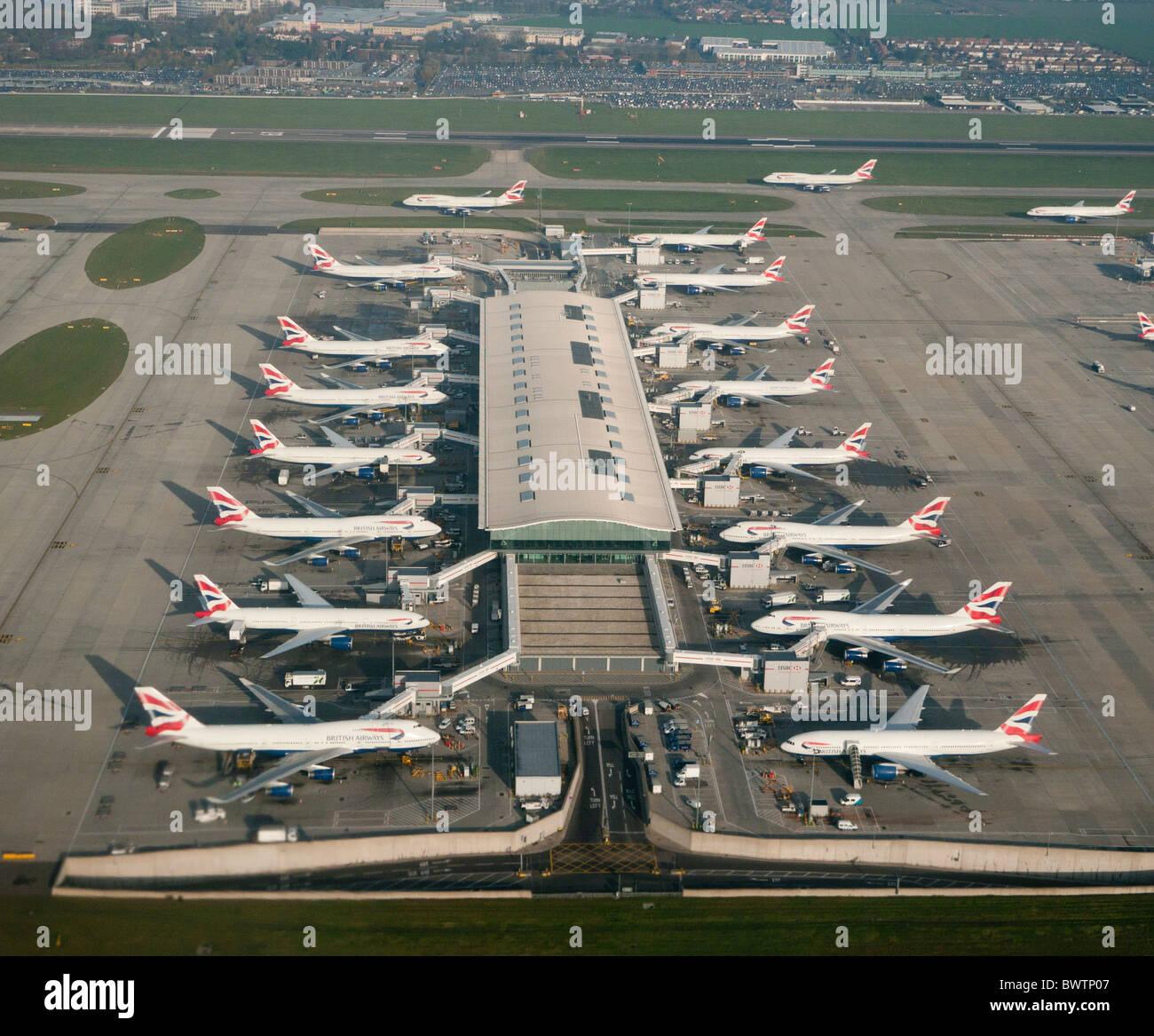 British airways planes at Terminal 5 Heathrow airport in Britain - Stock Image